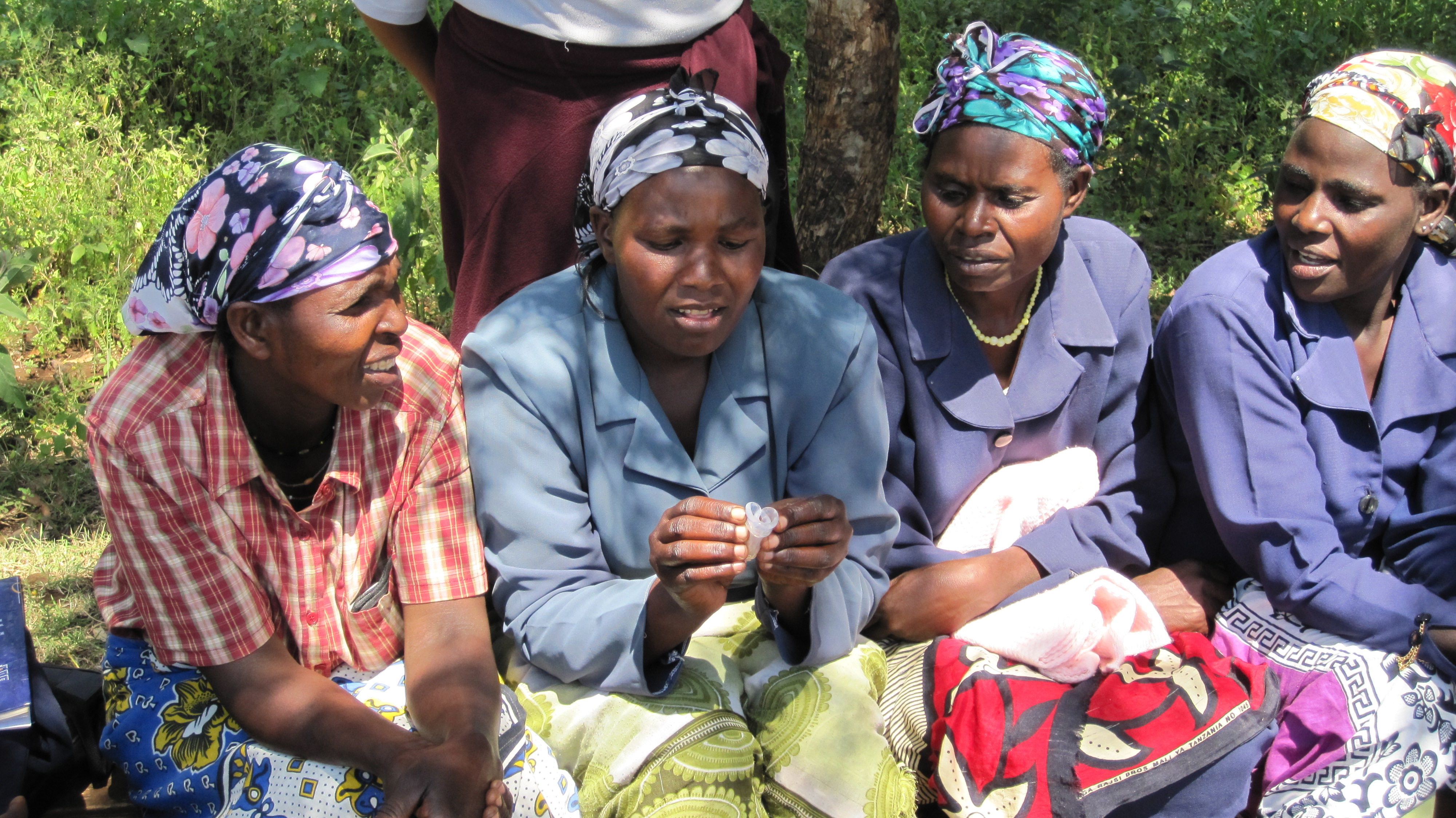 women_in_meru_kenya_examining_menstrual_cups_5926104507